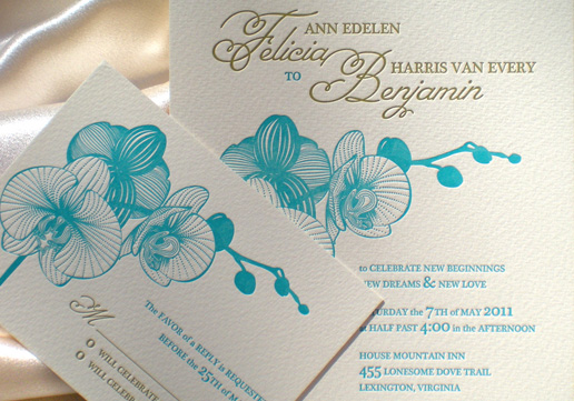 close up of letterpress orchid wedding invitation set